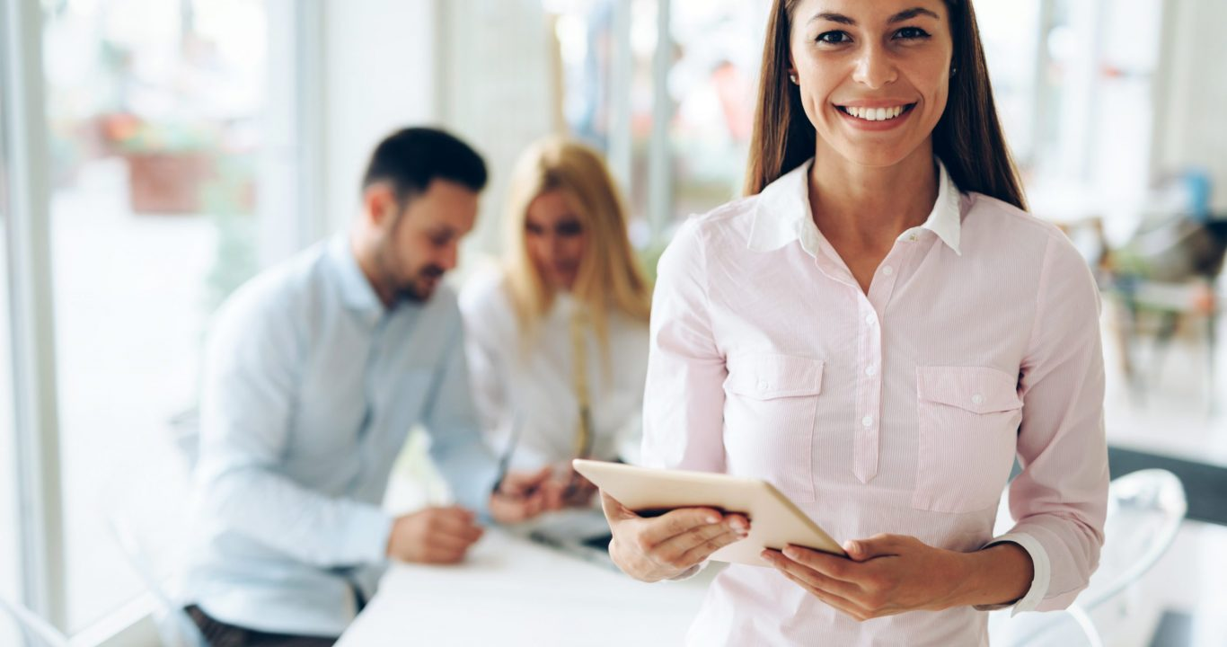 Portrait of successful businesswoman holding digital tablet in office
